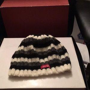 Black, cream and white hat